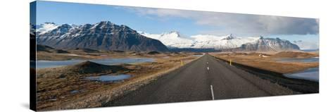 Road with Mountains in the Background, Iceland--Stretched Canvas Print