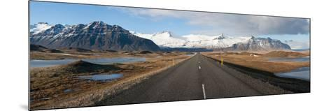 Road with Mountains in the Background, Iceland--Mounted Photographic Print