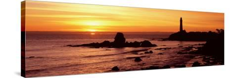 Silhouette of a Lighthouse at Sunset, Pigeon Point Lighthouse, San Mateo County, California, USA--Stretched Canvas Print