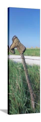 Cowboy Boot on a Fence, Pottawatomie County, Kansas, USA--Stretched Canvas Print