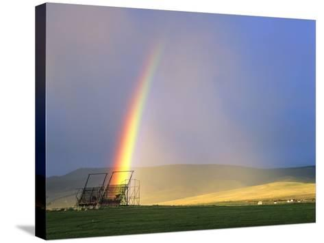 A Beaverslide Haystacker with Full Rainbow in the Big Hole Valley, Jackson, Montana, USA-Chuck Haney-Stretched Canvas Print