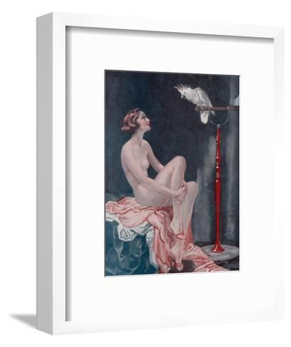 A Naked Woman Relaxing While Speaking to Her Cockatoo--Framed Art Print
