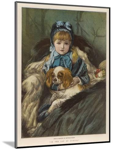 A Well-Wrapped Up Little Girl in a Carriage Holds Her Charley in Her Lap--Mounted Giclee Print