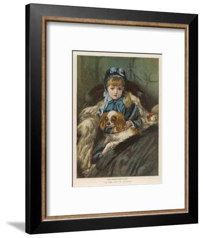 A Well-Wrapped Up Little Girl in a Carriage Holds Her Charley in Her Lap--Framed Art Print