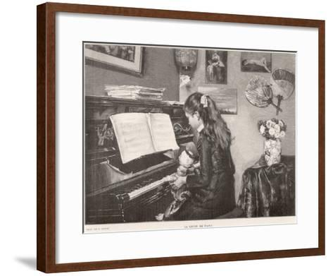 A Young Girl Sits Her Doll on Her Lap and 'teaches' it to Play the Piano--Framed Art Print