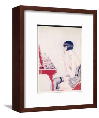 A Twenties Girl at Her Dressing Table Adds a Final Touch of Lipstick--Framed Art Print