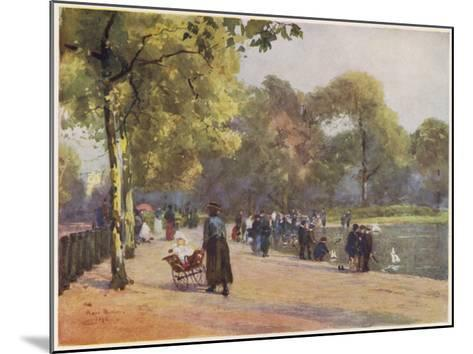 A Nanny Watches Children Play by the Serpentine, Kensington Gardens--Mounted Giclee Print