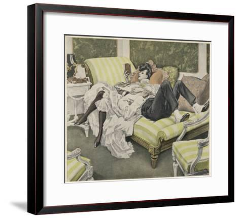 An Old Man with a White Beard and a Young Woman with a Book Relax on a Couch--Framed Art Print