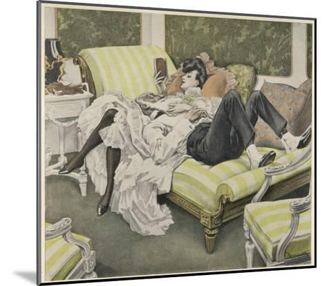 An Old Man with a White Beard and a Young Woman with a Book Relax on a Couch--Mounted Giclee Print