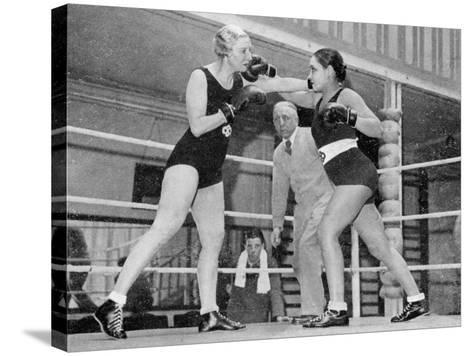 Two Women Box in a Ring, with a Referee Present--Stretched Canvas Print