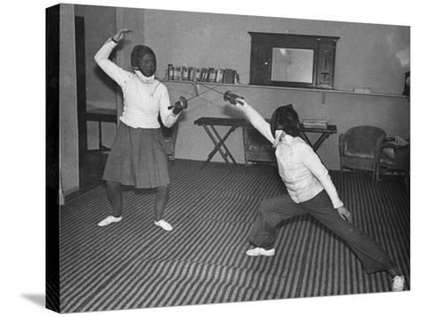 Two Waafs Fencing for Recreation During World War Ii-Robert Hunt-Stretched Canvas Print