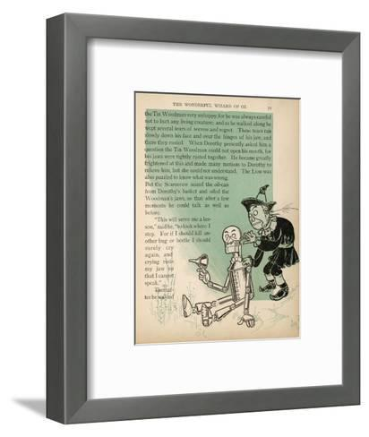 The Scarecrow Oils the Tin Woodman's Jaws after His Tears Cause Them to Rust--Framed Art Print
