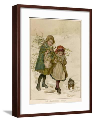Two Girls Accompanied by a Small Dog Gather Holly and Mistletoe--Framed Art Print