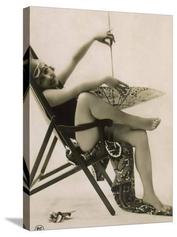 Attractive Woman Posing in Her Swimsuit in a Deckchair, with a Parasol--Stretched Canvas Print