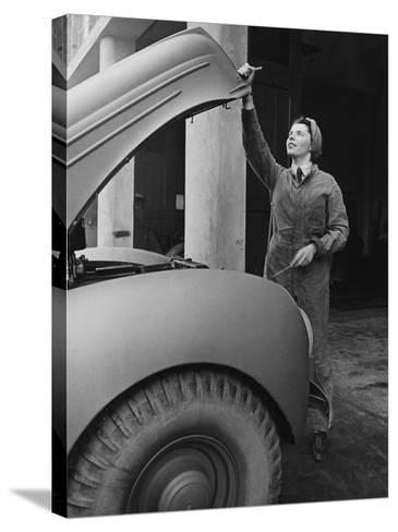 A Land Girl Mechanic Working on a Car During World War Ii-Robert Hunt-Stretched Canvas Print
