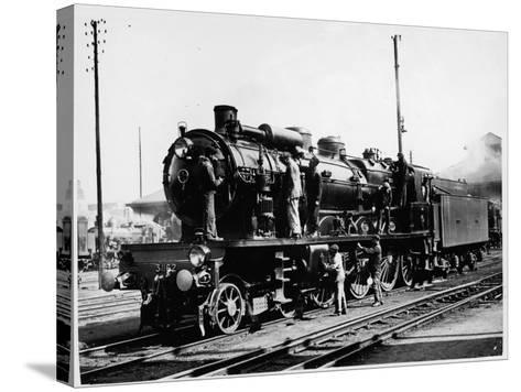 A Group of British Railway Engineers Carrying Out Safety Checks a Steam Locomotive--Stretched Canvas Print