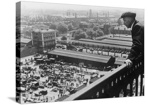 A Man Looks Down over the Old Caledonian Road Market, Caledonian Road, North London--Stretched Canvas Print