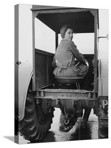 A Land Girl Driving a Tractor on a Farm During World War Ii-Robert Hunt-Stretched Canvas Print