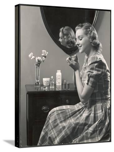 A Young Woman, Wearing a Madras Check Dress with Short Puff Sleeves, Paints Her Nails--Stretched Canvas Print