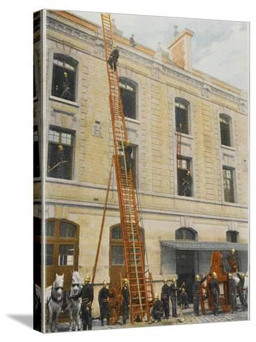 French Sapeurs-Pompiers Use a Long Ladder to Reach the Highest Floors of a Burning Building--Stretched Canvas Print