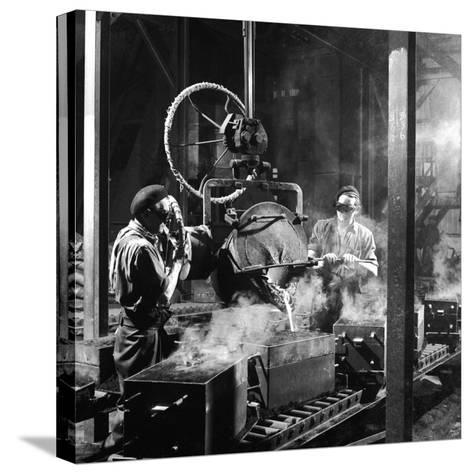 Molten Metal on a Production Line-Heinz Zinram-Stretched Canvas Print