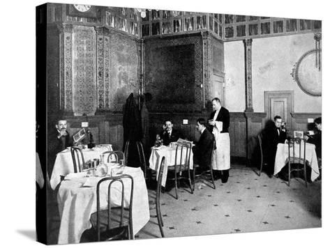 Restaurant Scene from 1910 Showing One Diner Using a Telephone at His Table--Stretched Canvas Print