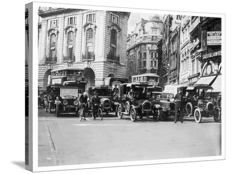 Policeman Directs Traffic Through Piccadilly Circus--Stretched Canvas Print