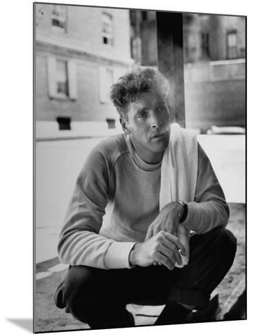 Actor Burt Lancaster, While Smoking Cigarette in Courtyard of Union Settlement House in E. Harlem-Robert Wheeler-Mounted Premium Photographic Print
