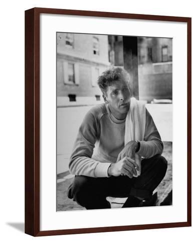 Actor Burt Lancaster, While Smoking Cigarette in Courtyard of Union Settlement House in E. Harlem-Robert Wheeler-Framed Art Print