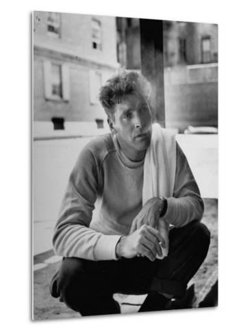 Actor Burt Lancaster, While Smoking Cigarette in Courtyard of Union Settlement House in E. Harlem-Robert Wheeler-Metal Print
