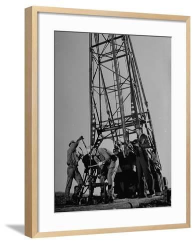 Phillips Petroleum Company Employees, Members of the Phillips 66 Champion Amateur Team, Working-Cornell Capa-Framed Art Print
