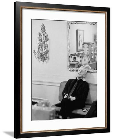 Pianist Artur Rubinstein Sitting on Couch and Holding Cigar During Restful Moment--Framed Art Print