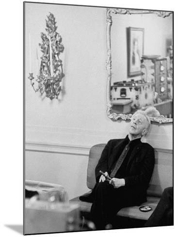 Pianist Artur Rubinstein Sitting on Couch and Holding Cigar During Restful Moment--Mounted Premium Photographic Print