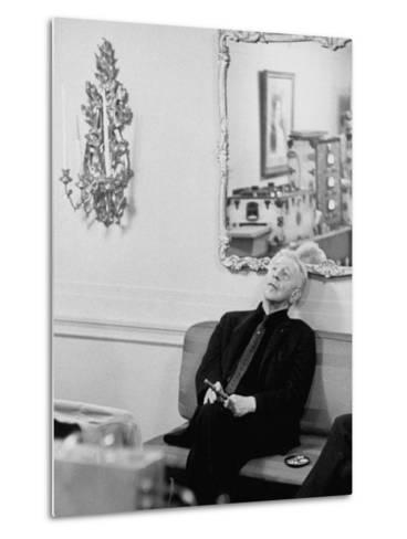 Pianist Artur Rubinstein Sitting on Couch and Holding Cigar During Restful Moment--Metal Print