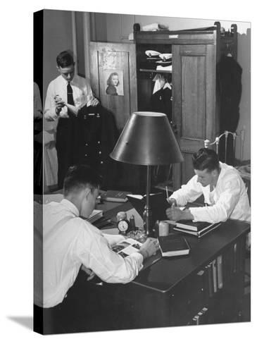 A View of Cadets at the Annapolis Naval Academy Studying in their Dorm Room-David Scherman-Stretched Canvas Print