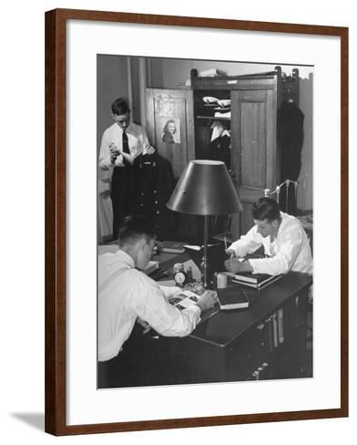 A View of Cadets at the Annapolis Naval Academy Studying in their Dorm Room-David Scherman-Framed Art Print