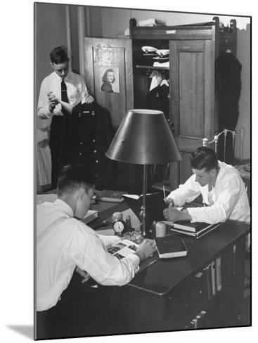 A View of Cadets at the Annapolis Naval Academy Studying in their Dorm Room-David Scherman-Mounted Premium Photographic Print