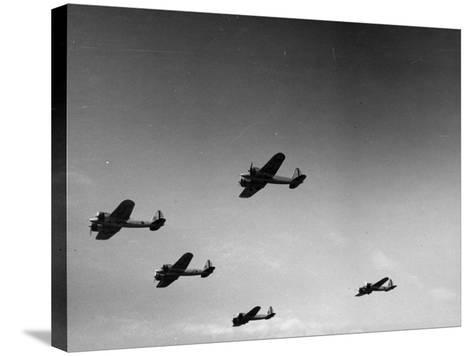 A View of Bomber Planes Being Used During US Army Maneuvers-John Phillips-Stretched Canvas Print