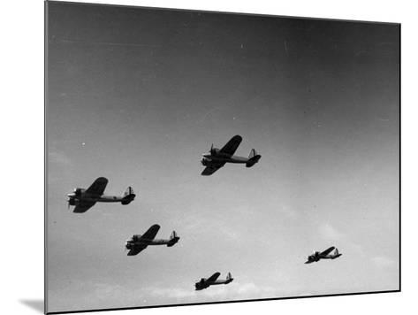 A View of Bomber Planes Being Used During US Army Maneuvers-John Phillips-Mounted Premium Photographic Print