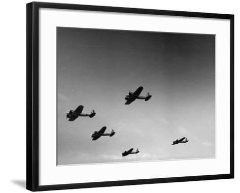 A View of Bomber Planes Being Used During US Army Maneuvers-John Phillips-Framed Art Print