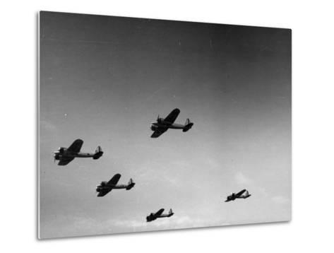 A View of Bomber Planes Being Used During US Army Maneuvers-John Phillips-Metal Print