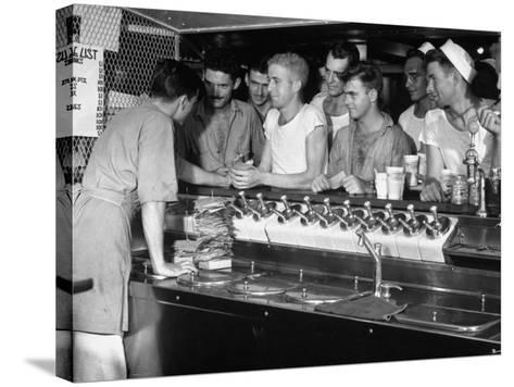 US Sailors Crowding around the Soda Fountain Aboard a Battleship-Carl Mydans-Stretched Canvas Print