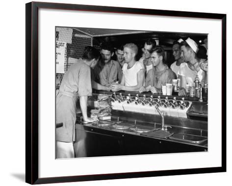 US Sailors Crowding around the Soda Fountain Aboard a Battleship-Carl Mydans-Framed Art Print