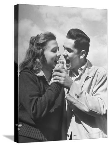 Boy and Girl Eating an Ice Cream Cone Together-Ed Clark-Stretched Canvas Print
