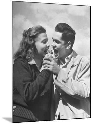 Boy and Girl Eating an Ice Cream Cone Together-Ed Clark-Mounted Premium Photographic Print