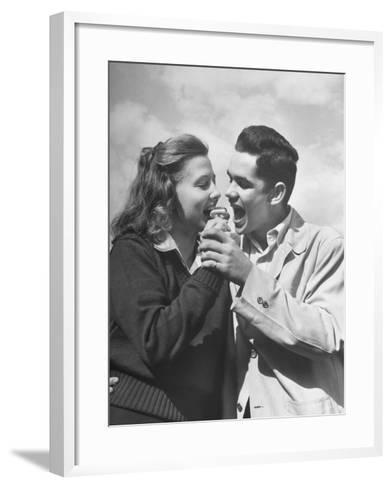 Boy and Girl Eating an Ice Cream Cone Together-Ed Clark-Framed Art Print
