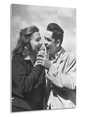 Boy and Girl Eating an Ice Cream Cone Together-Ed Clark-Metal Print