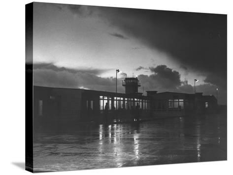 View of Airport and Runway at Dusk-Nat Farbman-Stretched Canvas Print