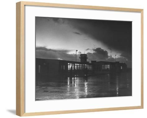View of Airport and Runway at Dusk-Nat Farbman-Framed Art Print