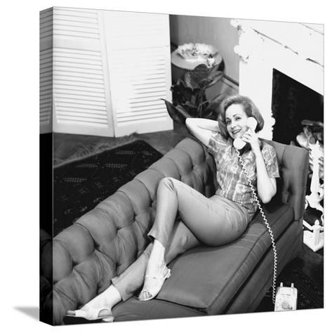 Woman Lying on Sofa, Talking on Phone-George Marks-Stretched Canvas Print